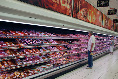 shopper selecting meat-meat lights